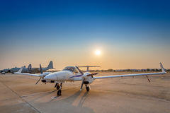 Airplane on the  runway during sunset. Airplane on the runway during sunset Stock Images
