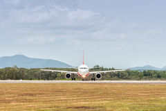 Airplane on a runway before take off Stock Photography