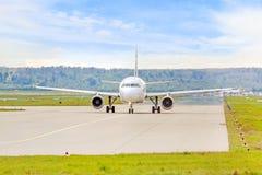 Plane at runway before takeoff Royalty Free Stock Photo