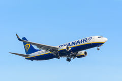 Airplane Ryanair  EI-DLX Boeing 737-800 is landing at Schiphol airport. Stock Image