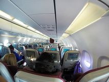 Airplane`s cabin with passengers Royalty Free Stock Image