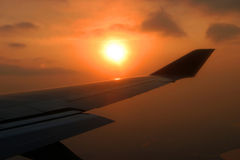 Airplane's wing. Airplane flying during sunset, airplane's wing royalty free stock photos
