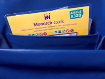 Airplane safety instructions card. Safety instructions in the seat pocket of a Monarch Airlines airbus airplane royalty free stock photos