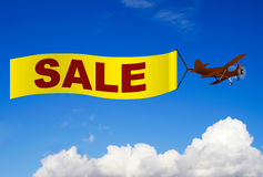Airplane with sale banner Royalty Free Stock Image