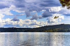 Airplane Seaplane Reflection Lake Coeur d` Alene Idaho. Seaplane Airplane Reflection Lake Coeur d` Alene Idaho royalty free stock image