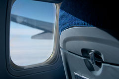 Airplane seat. Window view from airplane seat in economy class Stock Photography