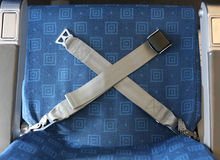 Airplane seat belt. Seat belt neatly placed for new arriving passengers royalty free stock photography
