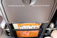 Budapest/hungary-29.08.18 : Airplane tray table desk easyjet safety food. Airplane seat tray table safety instruction on easyjet royalty free stock images
