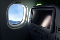 Airplane seat with tv screen Stock Photo