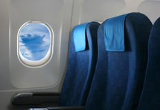 Airplane seat and window. Inside an aircraft Royalty Free Stock Photos