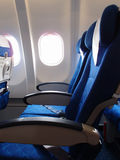Airplane seat and window. Inside an aircraft Royalty Free Stock Photo