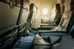 Airplane seat and window inside an aircraft stock photography