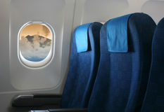 Airplane seat and window Stock Photos
