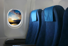 Airplane seat and window. Inside an aircraft with view on sea in Croatia royalty free stock photos