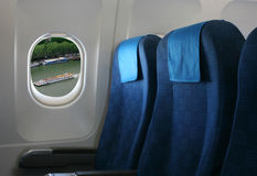 Airplane seat and window Royalty Free Stock Images