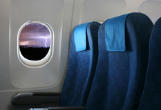 Airplane seat and window Stock Images