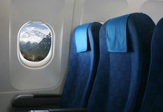 Airplane seat and window Royalty Free Stock Image