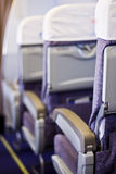 Airplane seats. A view looking down an aisle at rows of seats in a passenger airplane Royalty Free Stock Image