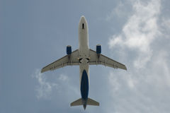 Airplane seen from the bottom. Airplane at takeoff seen from the bottom Royalty Free Stock Images