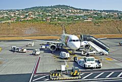 Aircraft servicing at the airport. Airplane servicing before departure form the airport on Madeira Island, Portugal Royalty Free Stock Photos