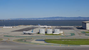 Airplane and SFO big character Stock Photography