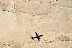 Airplane shadow above the desert Stock Photography
