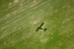 Airplane shadow on green field Stock Image