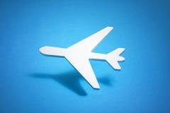 Airplane shape over blue background Stock Image