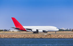 Airplane A380 Side Day Ground. Large two decks airplane departuring airport running runway sunny summer day side view in motion Royalty Free Stock Images