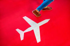 Airplane sign with female legs walking on the red Royalty Free Stock Images