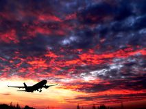 Airplane silhouette. Wrong weather with airplane silhouette royalty free stock image
