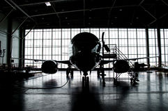 Airplane silhouette. In closed hangar Royalty Free Stock Images