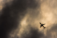 Airplane silhouette. Silhouette of an airplane flying into a thunderstorm Stock Photography