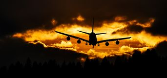 Airplane Silhouette on Air during Sunset Royalty Free Stock Photography