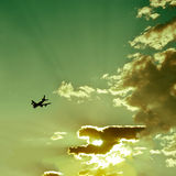 Airplane silhouette in beautiful sky stock photo