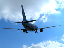 Airplane silhouette and blue cloudy sky Royalty Free Stock Photo