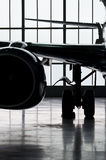 Airplane silhouette. In closed hangar Stock Photo