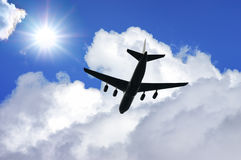 Airplane silhouette in deep blue sky. Airplane travel compositio Royalty Free Stock Photo