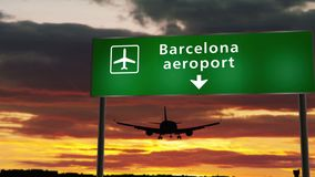 Plane landing in Barcelona. Airplane silhouette landing in Barcelona, Spain, Catalonia. City arrival with airport direction signboard and sunset in background stock video