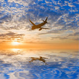 Airplane silhouette over a sea Royalty Free Stock Photo