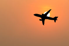 Airplane silhouette in the sky . Airplane silhouette in the sky at sunset Royalty Free Stock Photography
