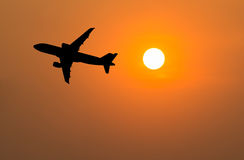 Airplane silhouette in the sky . Airplane silhouette in the sky at sunset Stock Photo