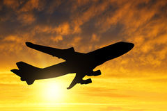 Airplane. Silhouette in the sunset Stock Images