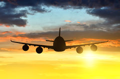 Airplane. Silhouette in the sunset Stock Photo