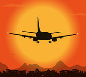 Airplane silhouette in the sunset Royalty Free Stock Images