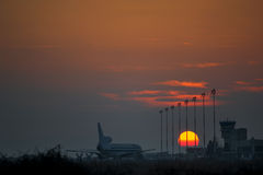 Airplane silhouette. Sunset scene with airplane silhouette Stock Photos