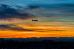 Airplane silhouette on sunset sky background Royalty Free Stock Image