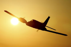 Airplane silhouette in the sunset. Two engine aircraft in the sky at sunset stock photography