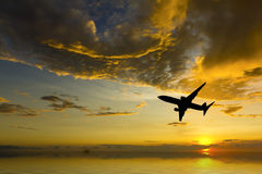 Airplane silhouette taking off. Airplane silhouetted taking off against dark brooding clouds. Aircraft and ocean is CGI Stock Photo
