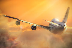 Airplane in The sky. An airplane flies over the clouds in the sky royalty free stock photo